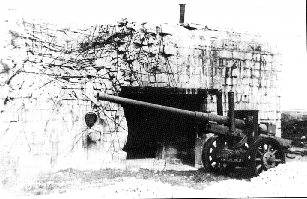 This German gun was captured outside theincomplete concrete emplacement